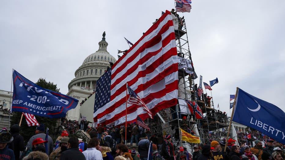 dac238ea-Trump supporters storm Capitol building in Washington