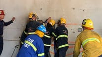 Firefighters free naked woman trapped between two buildings in Santa Ana