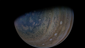 NASA probe offers dramatic glimpses of Jupiter and its moon Ganymede