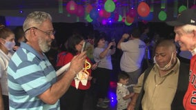 Gallery Furniture celebrating with neighbors living with autism