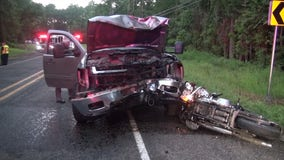 Motorcyclist killed, passenger injured after head-on crash with truck carrying tree debris