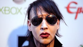 Marilyn Manson turns himself in to police over assault warrant