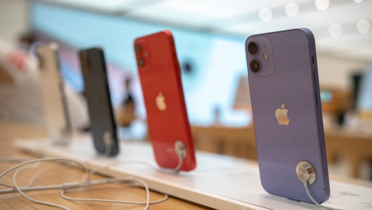 The iPhone 12 series are sold in an Apple store. With the