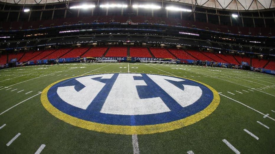 SEC logo football field