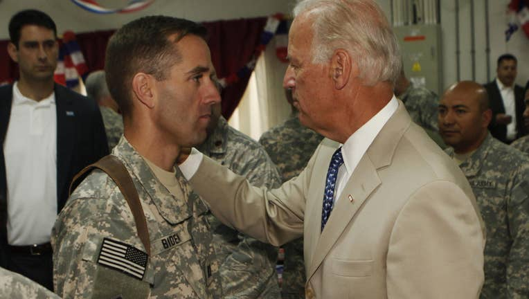U.S. Vice President Joe Biden (R) talks