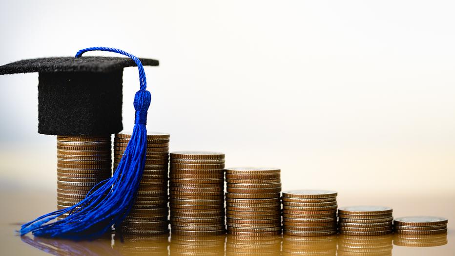 d4fd2e1a-private-student-loans-grad-cap-coins-credible-iStock-1162366190.png
