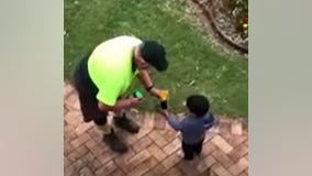 Sanitation worker, boy trade gifts in mutual acts of kindness