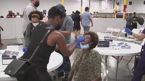 Hundreds of Haitian migrants begin arriving to a holding shelter in Houston