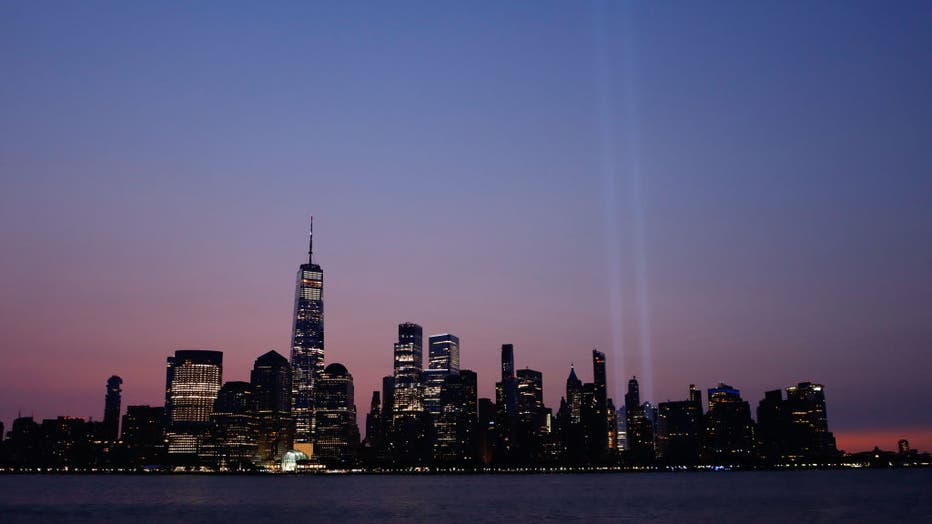 Tribute in Light Fades as the Sun Rises in New York City