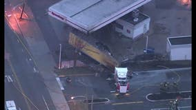 Truck crashes at gas station, brings down wires, catches fire