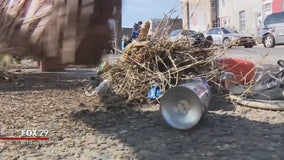 Volunteers with Philly Spring Cleanup polish a city ready for spring