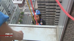 Alex Holley rappels 29 story building