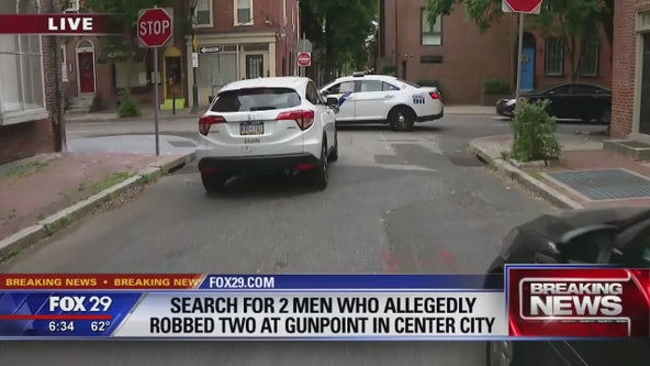 Police search for 2 men after couple robbed at gunpoint in Center City
