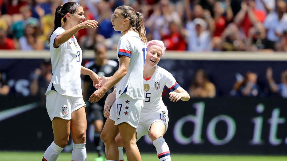 Tobin Heath #17 of the United States is congratulated by teammates Megan Rapinoe #15 and Alex Morgan #13 after she scored in the first half against Mexico at Red Bull Arena on May 26, 2019 in Harrison, New Jersey.