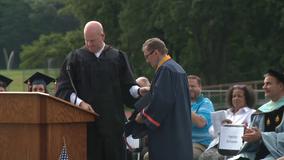 Vietnam veteran walks across stage for high school graduation 50 years later