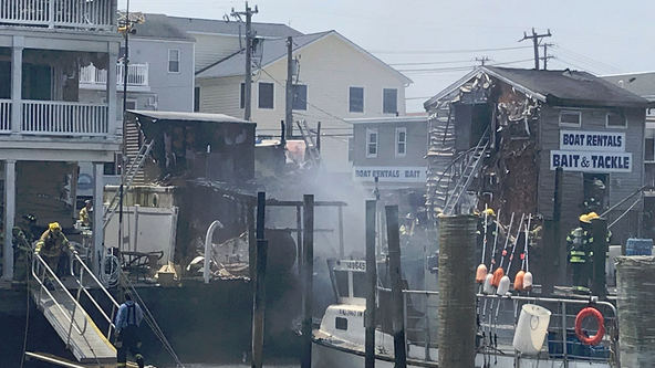 Crews battle heavy fire at boat rental shop in Sea Isle