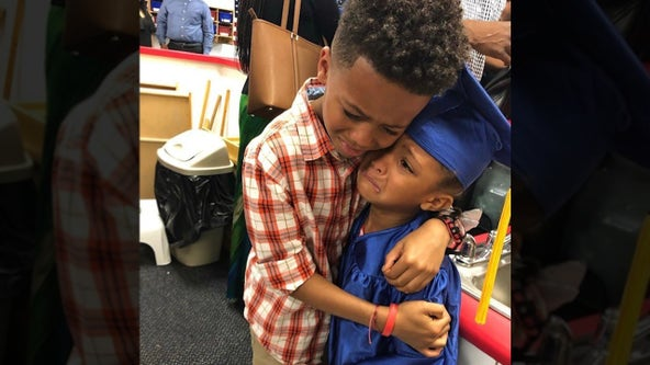 Photo of brother hugging his little sister after pre-school graduation goes viral
