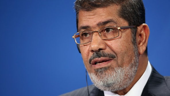 Egypt TV says ousted president Morsi dies in court
