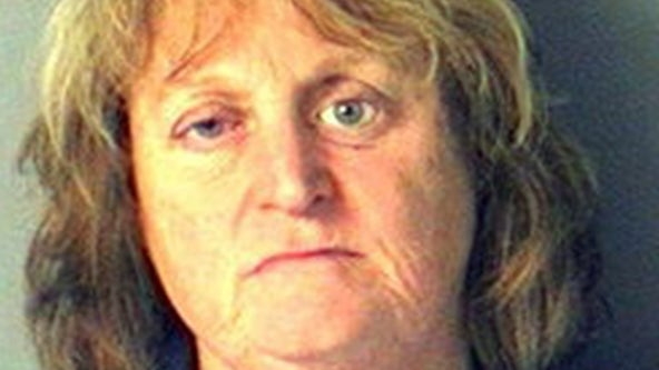 Woman accused of pushing elderly Golden Retriever into lake, watching it drown