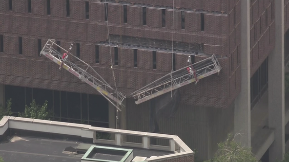 2 workers rescued after scaffolding collapses in University City