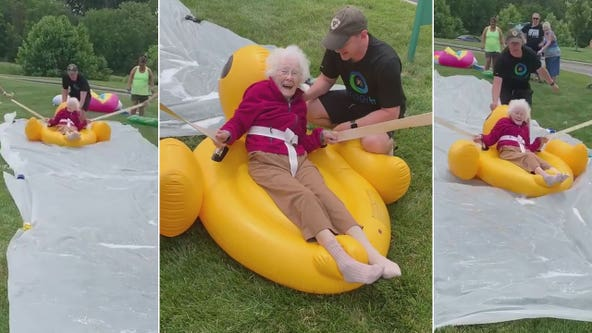 94-year-old woman joyously rides rubber duck float down senior home's makeshift slip 'n slide