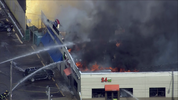 Firefighters battle 2-alarm fire at pharmacy and laundromat in Juniata Park