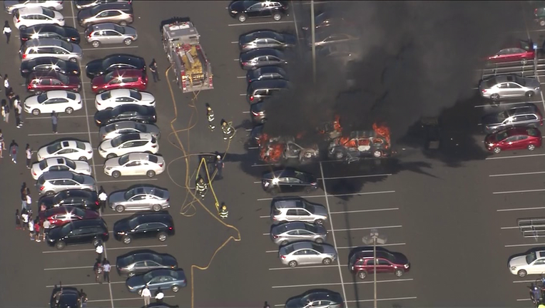 Skyfox over cars on fire at Franklin Mills Mall parking lot Friday.