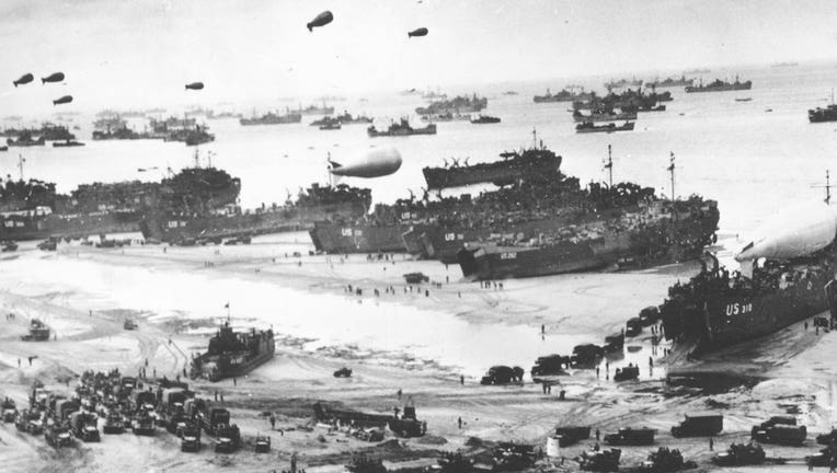 Fleets of ships and barrage balloons are shown in Normandy in a black and white July 14, 1944 photo.