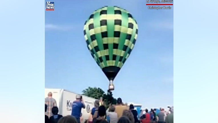 At least one person was hurt after an out-of-control hot air balloon ripped through a crowded festival in Missouri.