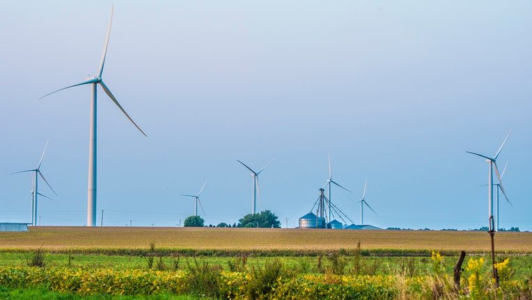 Wind turbines on the Bishop Hill wind farm operate among the corn and soybean fields near Bishop Hill, Ill., Sept. 14, 2017. USDA Photo by Preston Keres