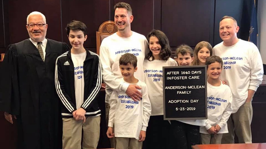 Steve and Rob Anderson-McLean are pictured with their six children and the judge.