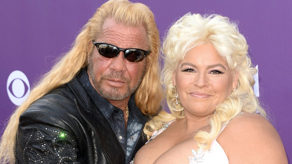 TV personalities Dog the Bounty Hunter (L) and Beth Chapman arrive at the 48th Annual Academy of Country Music Awards at the MGM Grand Garden Arena on April 7, 2013 in Las Vegas, Nevada. (Photo by Jason Merritt/Getty Images)