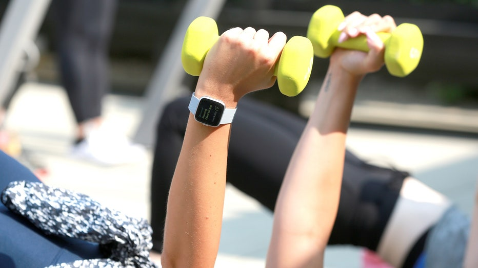 Women participate in a workout.