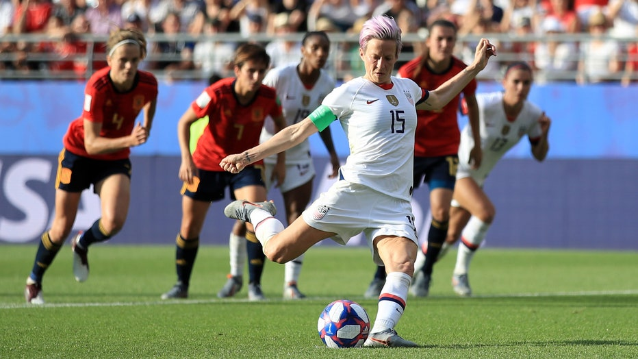 Megan Rapinoe of the USA scores her team's second goal from the penalty spot during the 2019 FIFA Women's World Cup France Round Of 16 match between Spain and USA on June 24, 2019 in Reims, France. (Photo by Marc Atkins/Getty Images)