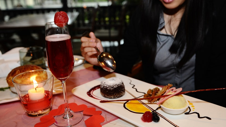 """The study found that women who held more traditional gender role beliefs as well as those who scored higher on the """"dark triad"""" of personality traits were most likely to have engaged in a foodie call. (Photo by Robertus Pudyanto/Getty Images)"""