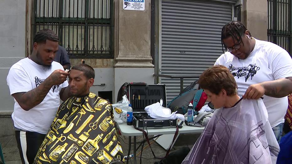 Joshua Santiago cuts hair in a fundraiser known as the 24 Hour Haircut 4 the Homeless in Kensington.