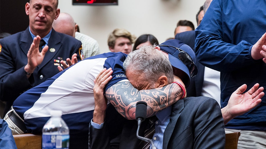 FealGood Foundation co-founder John Feal hugs former Daily Show Host Jon Stewart during a House Judiciary Committee hearing on reauthorization of the 9/11 Victim Compensation Fund on Capitol Hill on June 11, 2019.