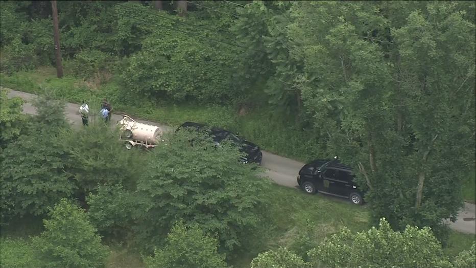 Pennsylvania game wardens search for black bear roaming free in Roxborough.