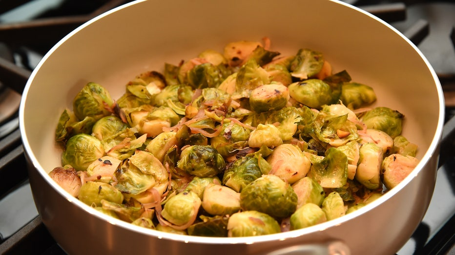 A 2015 file photo shows a Brussels spouts dish cooking over a stove. The USDA said prepared meals or leftovers are only safe for up to four days in the refrigerator. (Photo by Sean Gallup/Getty Images)