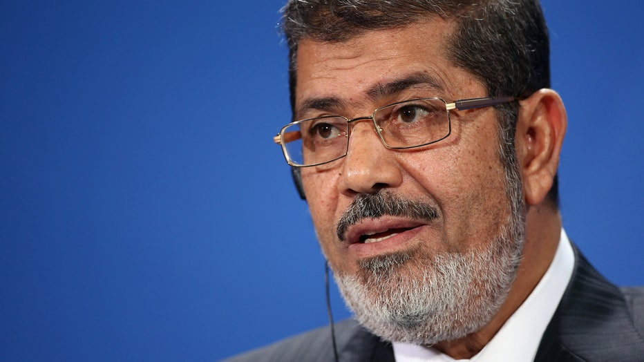 Egyptian President Mohammed Morsi speaks to the media with German Chancellor Angela Merkel (not pictured) following talks at the Chancellery on January 30, 2013 in Berlin, Germany.