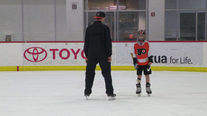 Flyers goalie Carter Hart skates with boy who had partial foot amputation
