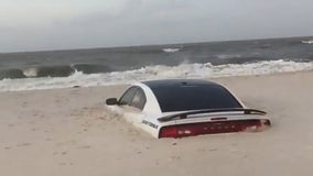 Car buried in sand on Alabama beach as Tropical Storm Barry approached