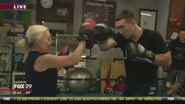 Jenn squares up with boxer Sonny Conto