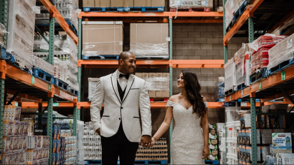 Couple takes epic wedding photos in Costco aisle where they first met