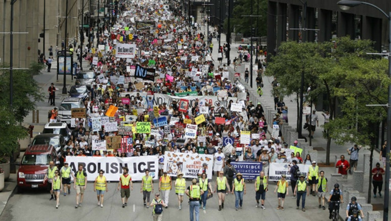 The protesters at Saturday's Chicago march belted chants critical of President Donald Trump and the Immigration and Customs Enforcement agency.