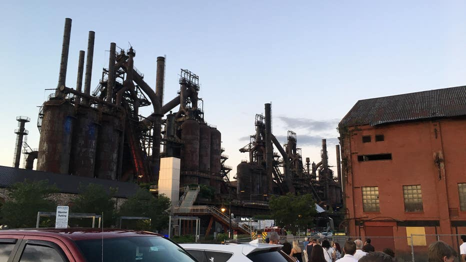 Authorities say a man climbed to the top of a former Bethlehem Steel Corp. blast furnace and refused to come down, prompting evacuation of the arts and entertainment venue at the eastern Pennsylvania site.