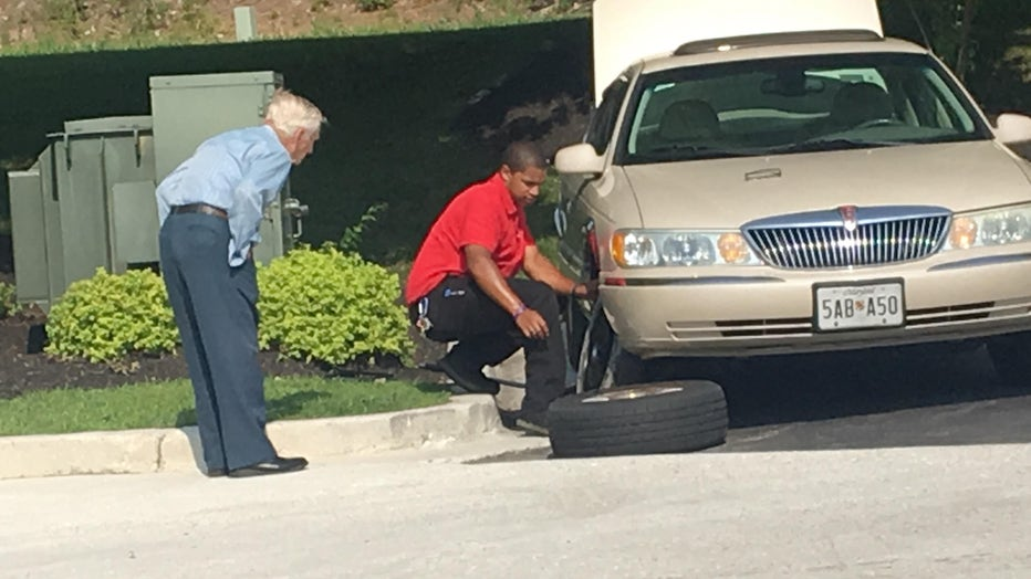 Chick-Fil-A manager Daryl Howard is seen coming to the aid of a 96-year-old man with a flat tire outside of a restaurant in Severn, Maryland. (Photo credit: Rudy Somoza)