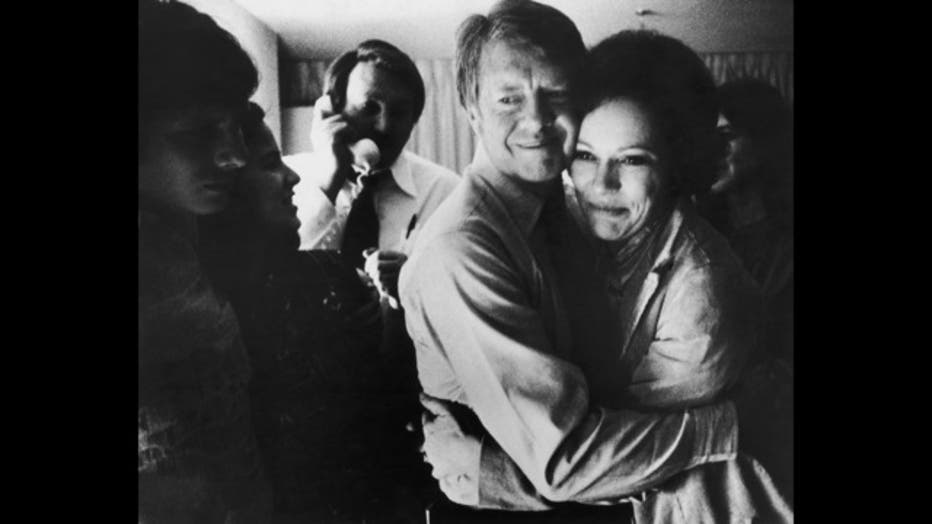 Democratic presidential candidate Jimmy Carter embraces his wife Rosalynn after receiving the final news of his victory in the national general election, November 2, 1976. (Photo by Hulton Archive Getty Images)