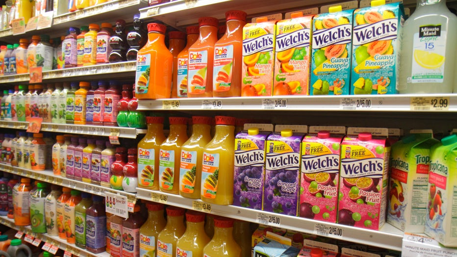 Shelves of fruit juices are shown in this file image at a grocery store. (Photo by: Jeffrey Greenberg/Universal Images Group via Getty Images)