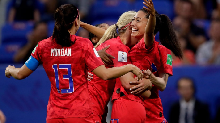 Alex Morgan, Lindsey Horan and Christen Press celebrate during the World Cup Women match between England v USA at the Stade de Lyon on July 2, 2019 in Lyon France (Photo by Eric Verhoeven/Soccrates/Getty Images)